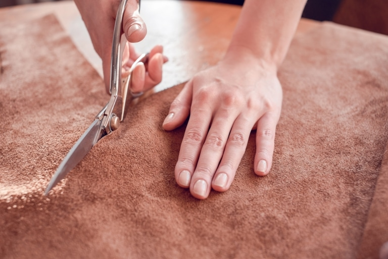 Cutting leather with scissors